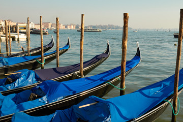 Venice gondolas pier with blue gondola in Italia