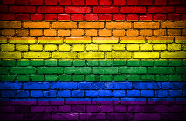 Brick wall with painted flag of Pride