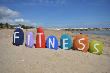 Fitness, conceptual stones composition on the sand