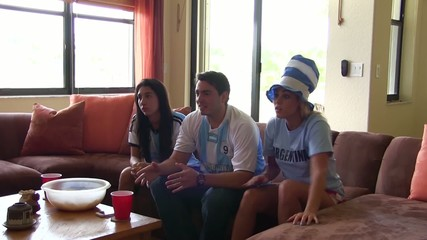 Group of happy Argentina soccer fans. Goal Celebration