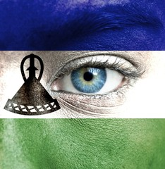 Human face painted with flag of Lesotho