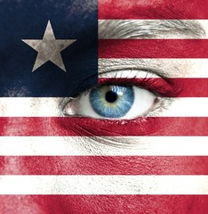Human face painted with flag of Liberia