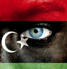 Human face painted with flag of Libya