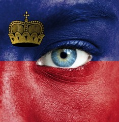 Human face painted with flag of Liechtenstein
