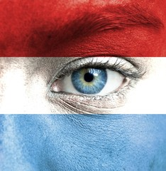 Human face painted with flag of Luxembourg