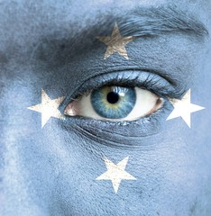 Human face painted with flag of Micronesia