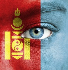 Human face painted with flag of Mongolia