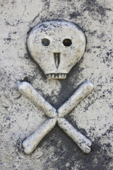 Death head on ancient tombstone in Lozisca, Brac island, Croatia