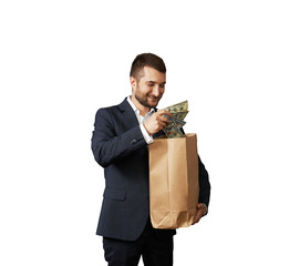 smiley man with paper bag and money