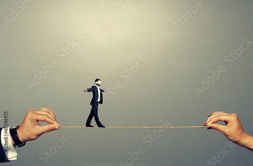 small man walking on the rope