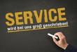 Service Kundenservice - Slogan auf Kreidetafel