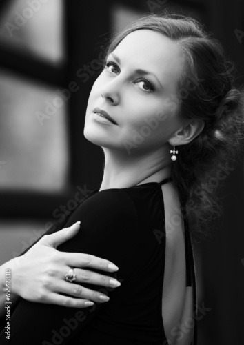 Happy fashion woman in black dress