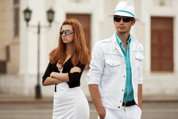 Young couple in conflict on the city street