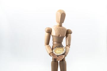 Zeichenpuppe mit Euro-Münze
