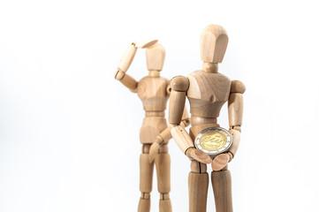 Zeichenpuppen mit Euro-Münze