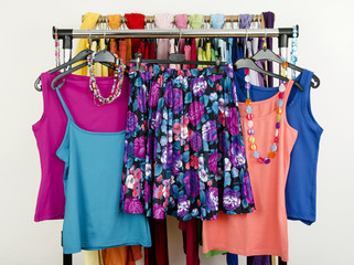 Summer outfits on a rack.Floral skirt with matching tank tops