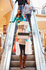 Woman Carrying Boxes And Bags In Shopping Mall