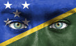 Human face painted with flag of Solomon Islands