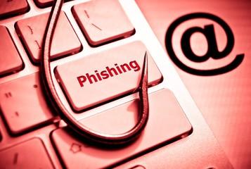 phishing / fish hook on computer keyboard