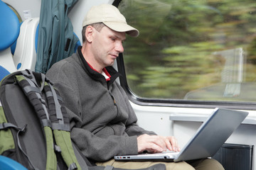 Tourist with laptop in the train