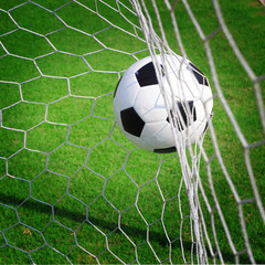 soccer ball in goal © somkanokwan