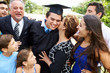 Hispanic Student And Family Celebrating Graduation - 65573258