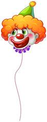 A colourful clown balloon with a string