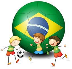 Boys playing soccer with the flag of Brazil