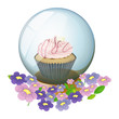 A crystal ball with a cupcake and flowers