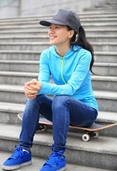 woman skateboarder sit rest on stairs