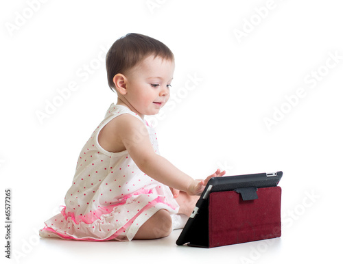 child girl playing with a digital tablet