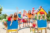 Fototapety Happy kids playing on playground