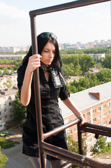 young woman on fire-escape