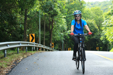Woman mountain biking on the road