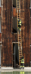 firefighters with ladder during a practice session in the Fireho