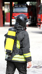 firefighter with the oxygen cylinder and the helmet