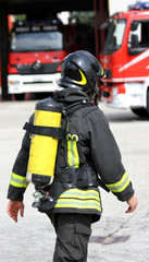 firefighter with yellow oxygen cylinder and the helmet
