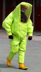 person with anti radiation suit yellow and yellow rubber boots t