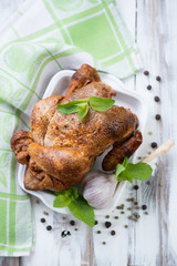 Grilled chicken with mint leaves and spices, high angle view