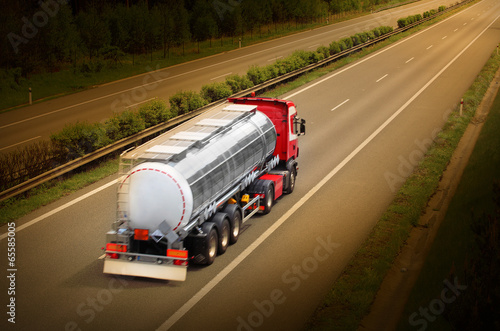 Motion blurred tanker truck on the highway. - 65585005