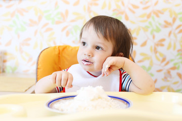 wistful baby eating quark