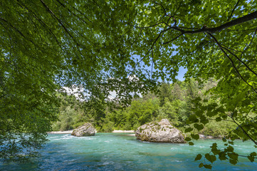 Turquoise river with boulders