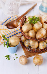 Fresh organic potatoes in a vintage rustic basket