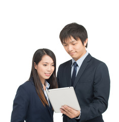 Asian businessman and businesswoman using tablet computer analyz