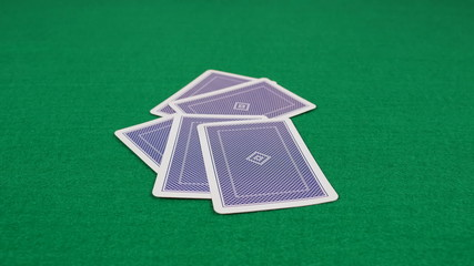 Poker Game Cards dealt to Player by Dealer on Felt Table