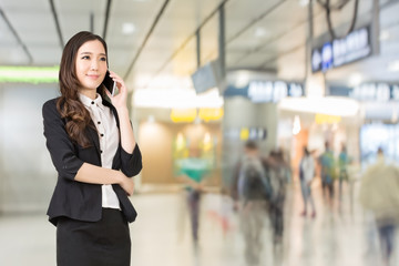 Asian business woman talking on cellphone