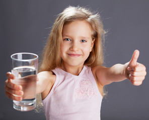 Girl drinking water from glass