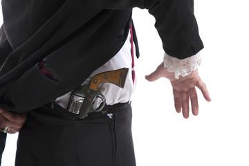 Man holding a gun behind his back
