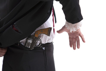 Man holding a gun behind his back