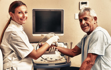 Woman doctor examing patient man wrist with ultrasound